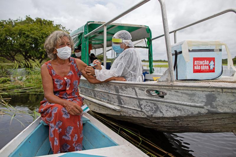 A health worker inoculates 72-year-old Olga D'arc Pimentel with a dose of Oxford-AstraZeneca's COVID-19 vaccine. She lives on the banks of the Rio Negro near Manaus, Brazil. A small study in South Africa has raised concerns about the AstraZeneca vaccine's