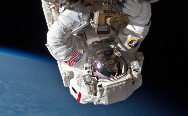 NASA astronaut Chris Cassidy performs a spacewalk in May to inspect and replace a pump controller box on the International Space Station. On Saturday, two astronauts will perform the first in a series of similar spacewalks to fix a broken cooling line on