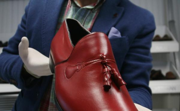 Armando Martin Dueñas shows a replica of one of the hand-crafted loafers that were given to Pope Benedict XVI during his March 2012 visit to Mexico at the Ackerman shoe factory in Leon, Mexico.