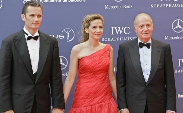 Spain's King Juan Carlos, his daughter Infanta Cristina and her husband, Inaki Urdangarin, are seen together on May 22, 2006. A corruption scandal involving Urdangarin, as well as the royal family's lifestyle is contributing to the public's diminishing re