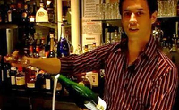 Brice from the Bubble Lounge in New York City demonstrates how to saber a bottle of champagne.