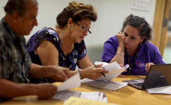 Affordable Care Act navigator Nini Hadwen helps Floridians shop for health insurance in October.