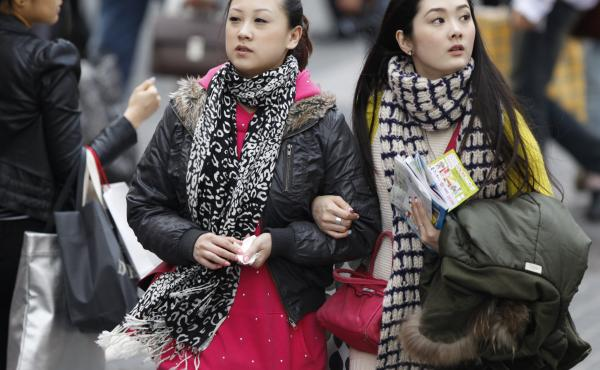 Carrying on as usual: Shoppers in central Seoul on Monday.