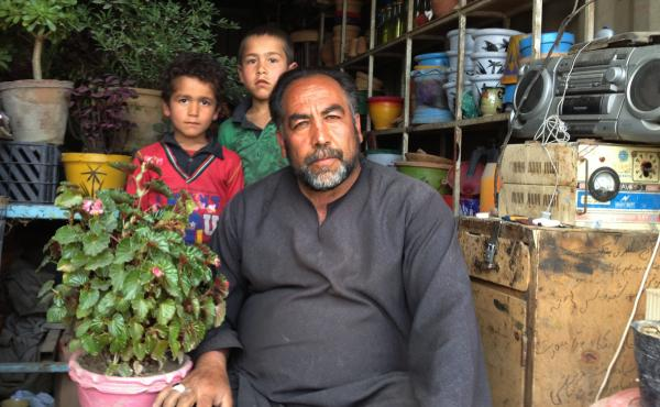 Saifulzul Husseini (right) works in Dashti Barchi, a Hazara neighborhood of Kabul. He believes that ethnicity should be listed on the new identity card.