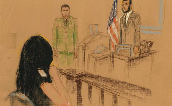 """Omar Khadr apologizes to Tabitha Speer, who shakes her head """"no"""" and weeps."""