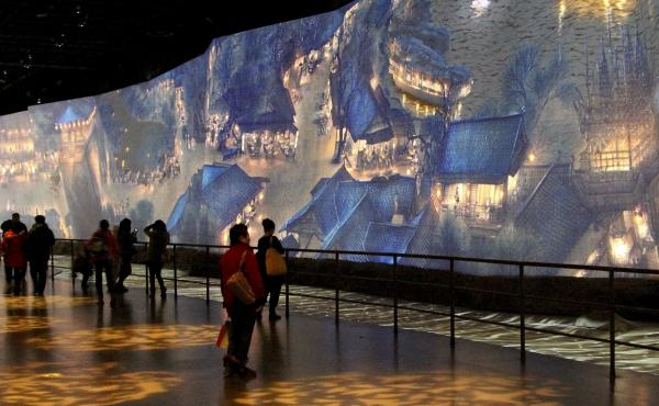 """One of the highlights of the new China Art Palace in Shanghai is a giant digital rendering of a famous ancient scroll, """"Along the River During Qingming Festival,"""" which includes figures that walk and talk. The work was first presented at the 2010 World Ex"""
