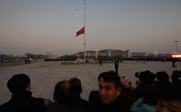 The Chinese flag is seen in front of a view of the moon at Beijing's Tiananmen Square in December, when China's first moon rover touched the lunar surface. That feat was widely celebrated — but observers believe the rover has now run into serious troubl