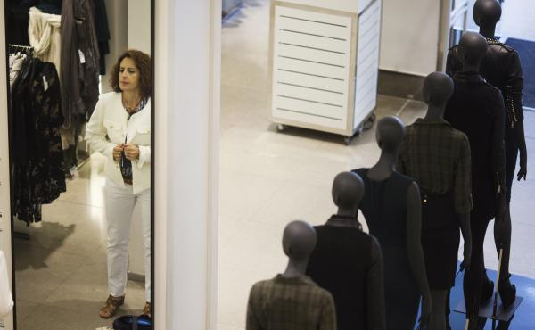 A woman tries on a jacket at a Zara store in Madrid. Zara's parent company, Inditex, was among Spanish companies to sign fire and building safety agreements for their factories in Bangladesh following a deadly factory collapse in April, though Inditex was