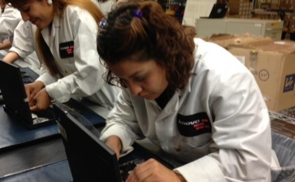 Johana Guardado assembles a laptop on Lenovo's new personal computer production line in Whitsett, N.C.