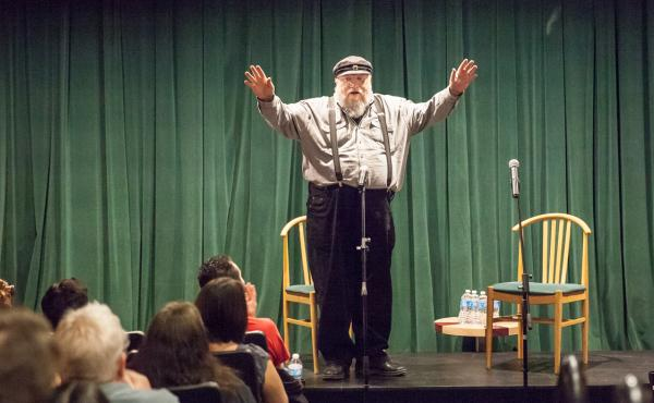 George R.R. Martin prepares to introduce author Neil Gaiman and performer Amanda Palmer at charity benefit at his newly renovated Jean Cocteau cinema in Santa Fe, N.M., on Sept. 29. Reopening the old movie house has been a passion project for the Game of