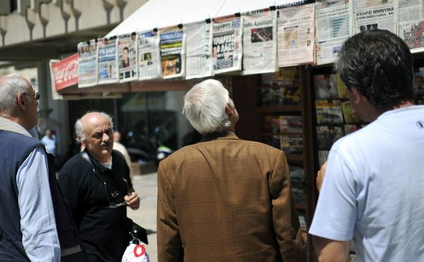 People read newspaper headlines in Athens. In 2009, there were 39 national dailies, 23 national Sunday papers, 14 national weekly papers and dozens of TV and radio stations for a population of 11 million.