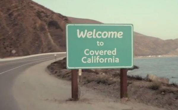 A sign in a TV ad welcomes Californians to insurance coverage.