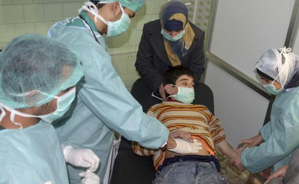 Doctors at a hospital in Aleppo, Syria, treat a boy injured in what the government said was a chemical weapons attack on March 19. Syria's government and rebels accused each other of firing a rocket loaded with chemical agents outside of Aleppo.