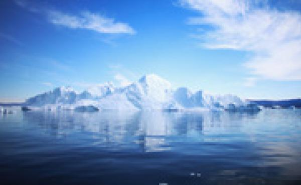 An iceberg floats through the water in Ilulissat, Greenland, in July. Researchers are studying how climate change and melting glaciers will affect the rest of the world.