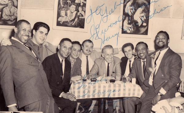 "Gabe Baltazar (fourth from left) at New York City's Birdland Club in 1962, with members of Stan Kenton's band and the Count Basie Orchestra. The photo, from Baltazar's collection, is signed by Kenton (fourth from from right) and trumpeter Harry ""Sweets"" E"