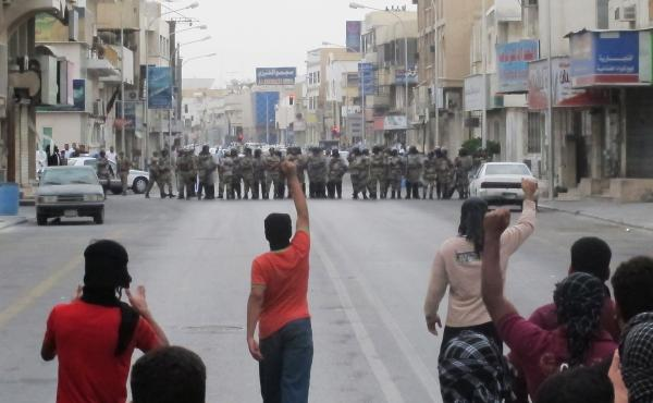 Anti-riot police face off with protesters in Saudi Arabia's eastern city of Qatif on March 11, 2011. Despite bans on the demonstrations, Shiite Muslims in the eastern part of the country have continued to stage protests, demanding political changes.