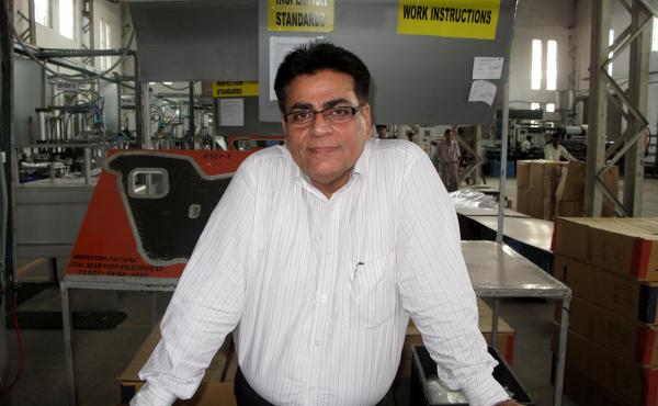Rahul Kacker owns a factory that makes car components. His business has been hit by the economic slowdown.