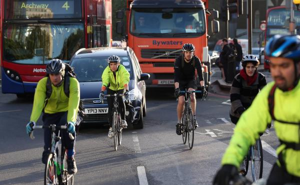 Cyclists negotiate rush hour traffic in central London on Nov. 15. Fourteen London cyclists have died so far this year, all in accidents involving heavy goods vehicles.
