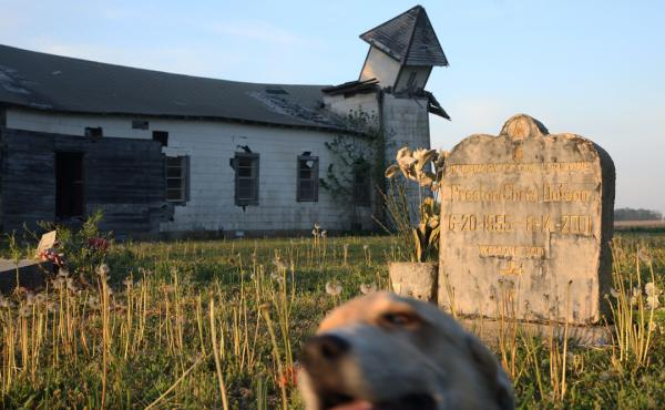 """""""The Peter's Rock Church in Marianna is no everlasting monument; it has been left to rot, its windows broken, its steeple fallen over. Still, I found it beautiful. Kneeling in the cemetery, listening to the insects hissing, watching as a dog wandered past"""