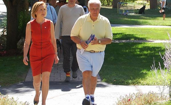 Republican presidential candidate Carly Fiorina walks the streets of Manchester, NH with Mayor Ted Gastas. Gastas has also campaigned with three other GOP candidates this year.
