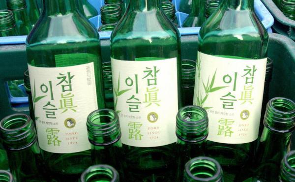 Boxes of empty Jinro soju bottles sit in a downtown Seoul, South Korea, shop on April 1, 2005.