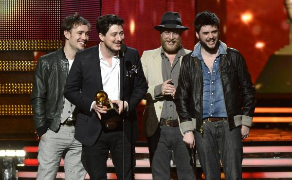 Mumford & Sons (from left: Ben Lovett, Marcus Mumford, Ted Dwane and Winston Marshall) accept the award for album of the year at the Grammy Awards on Sunday night.