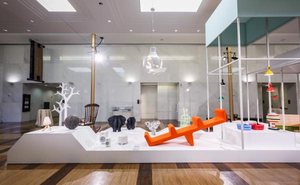 The Nordic design exhibit includes a lava rock, which Jukka Savolainen, director of the Design Museum in Helsinki, says reminds him of a gnome. The collection showcases the region's design roots, which include references to Bauhaus and 20th century modern