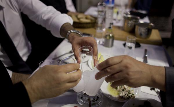 Diners drinking raki, a traditional Turkish alcoholic drink flavored with anise, at a restaurant in Istanbul.