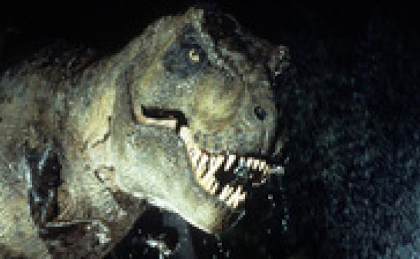 Mind The Teeth: Fossils indicate that Tyrannosaurus rex was an active hunter, in addition to being a scavenger. And in Jurassic Park, it also had a sweet tooth for lawyers.