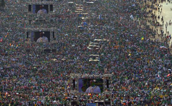 Hundreds of thousands of people crowd Copacabana Beach in Rio de Janeiro on Sunday as Pope Francis celebrates the final Mass of his visit to Brazil. Security lapses, traffic chaos and other logistical snafus marred the visit.
