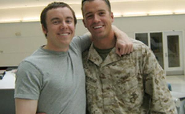 Luke and Mark Radlinski reunite at the airport after Mark's deployment in 2007.