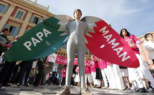 """A man wears a costume reading """"Dad"""" and """"Mom"""" during a demonstration against gay marriage and adoption by same-sex couples in Nice, France, in October."""
