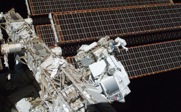 Astronauts work to install the alpha magnetic spectrometer on the International Space Station on May 26, 2011.