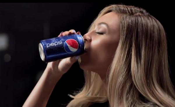 "Beyonce in her most recent Pepsi ad, which premiered her song ""Grown Woman."""