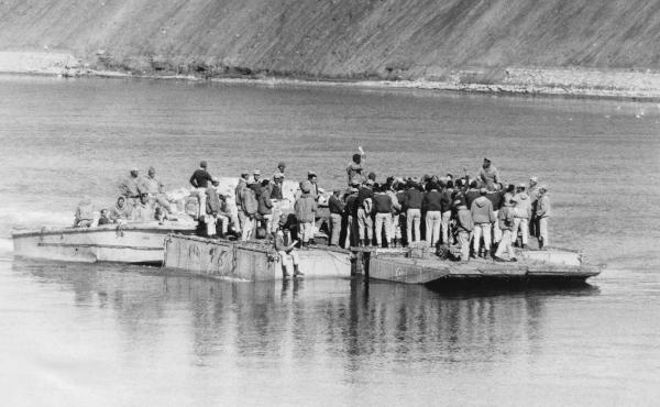 Egyptian soldiers cross to the eastern side of the Suez Canal during the 1973 war. Egyptian forces initially broke through the Israeli forces on that side of the canal.