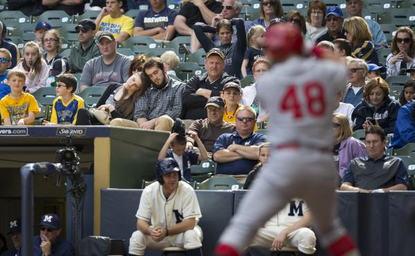 Two fans catch a nap during a game between the Milwaukee Brewers and St. Louis Cardinals last month in Milwaukee.