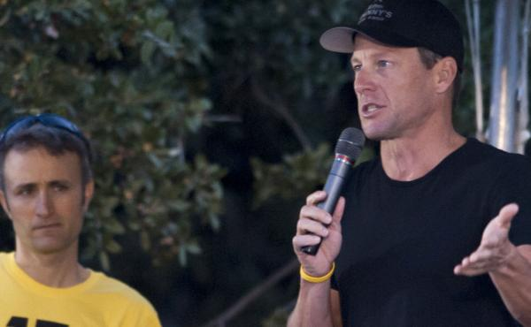 Lance Armstrong, seen here at a LIVESTRONG Challenge Ride in October 2012, might be willing to confess to doping — in exchange for an easing of his lifetime ban, according to reports.