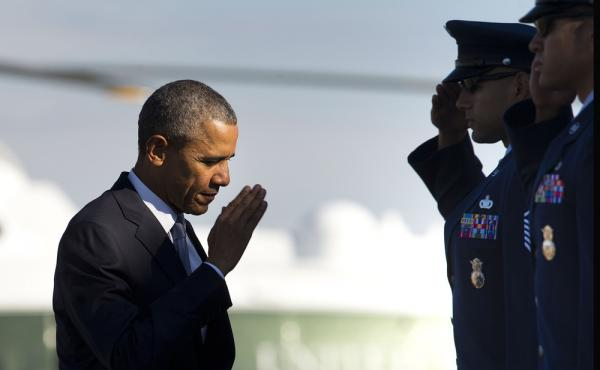 President Obama salutes prior to boarding Air Force One last Friday. The president entered office saying he would end the U.S. role in the Iraq and Afghan wars. But U.S. forces were sent back to Iraq last year and he announced Thursday that 5,500 American
