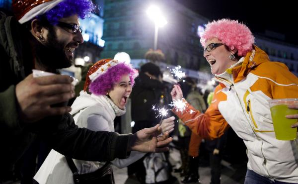 People celebrate New Year's in Madrid's Puerta del Sol square, on Jan. 1, 2011. Traditionally, the drinking doesn't begin until after midnight, when people eat 12 grapes for good luck.