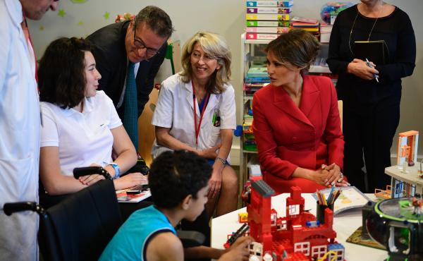 Melania Trump speaks with people during a visit to the Necker Hospital in Paris, on July 13, 2017.