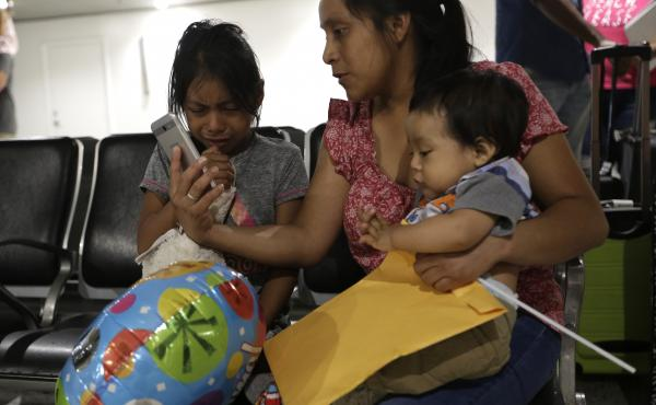 A Guatemalan woman holds her son as she is reunited with her daughter, who was released on July 1 from a child welfare agency in Michigan. Other young children have been going through deportation proceedings while separated from their parents.