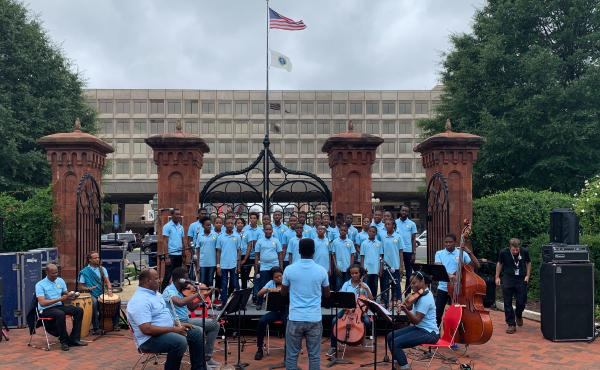 Holy Trinity Music School's youth choir and chamber orchestra perform in the Smithsonian's Enid A. Haupt garden in Washington, D.C.