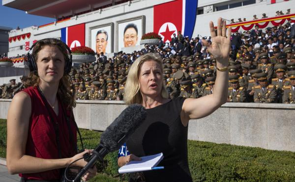 All Things Considered host Mary Louise Kelly (right) records a standup with producer Becky Sullivan at Kim Il Sung Square in Pyongyang ahead of a military parade marking the 70th anniversary of North Korea's founding.