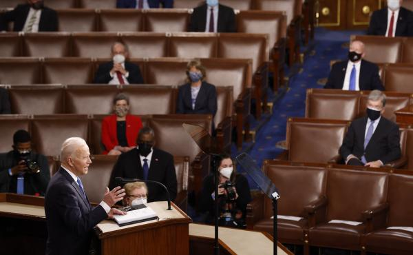 WASHINGTON, DC - APRIL 28: President Joe Biden addresses a Joint Session of Congress, with Speaker of the House Nancy Pelosi and Vice President Kamala Harris behind, on Capitol Hill in Washington DC.