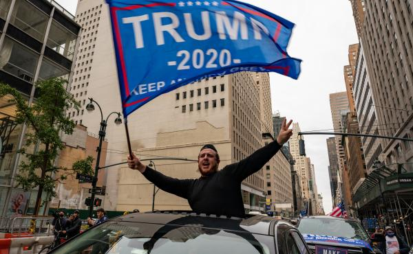 A person participates in a rally Sunday for President Trump on Fifth Avenue in New York City. Trump supporters and protesters clashed in Times Square, prompting nearly a dozen arrests.