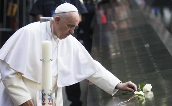 Pope Francis places a white rose at the South Pool of the Sept. 11 memorial in downtown Manhattan on Friday.