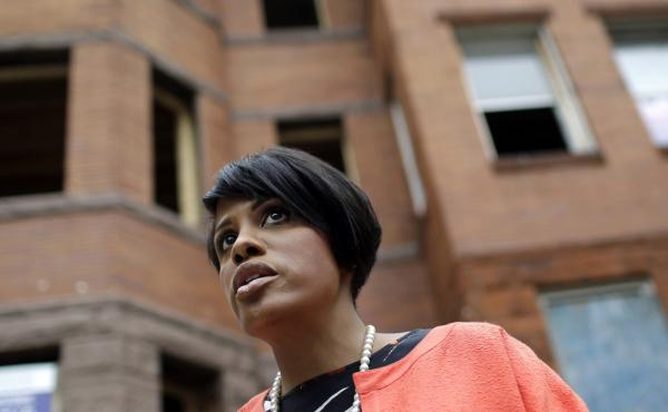 Baltimore Mayor Stephanie Rawlings-Blake stands outside vacant homes before a ceremony to kick off their restoration in Baltimore in July. In the wake of the riots triggered by the death of Freddie Gray, Rawlings-Blake announced Friday she will not seek r