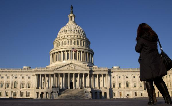 A woman looks on at the U.S. Capitol in 2013 after the most recent government shutdown. Congress has made no progress toward avoiding a government shutdown when it will run out of funding Sept. 30.