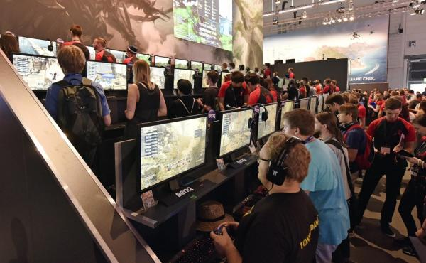 Participants play the latest video games at the gamescom computer game fair in Cologne, Germany, on Wednesday. The Electronic Sports League, which sponsors a tournament in the city later this month, says it will require random drug tests to ensure players
