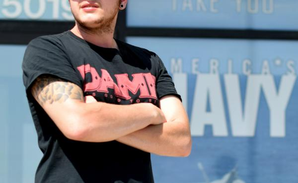 Zachary Gallegos, 23, stands guard outside the Armed Services Recruiting Center on Thursday in Sioux Falls, South Dakota. The Pentagon has asked such self-appointed